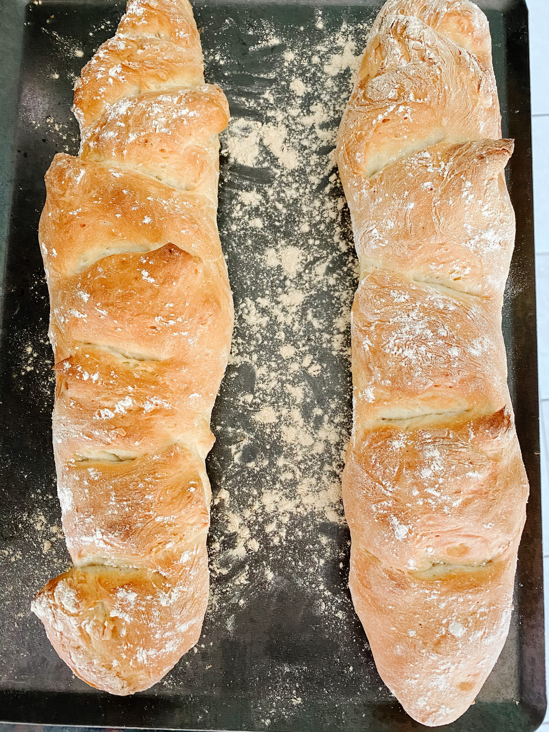 fresh baked baguettes on a cooking tray