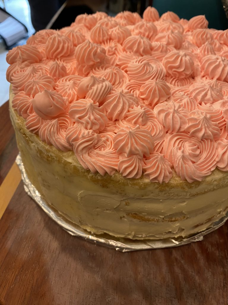 Pink buttercream icing on the birthday cake