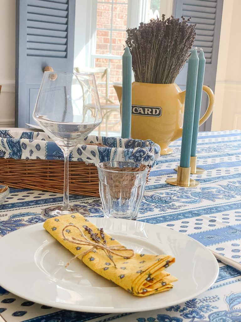 French Riviera themed table setting in blues and yellows