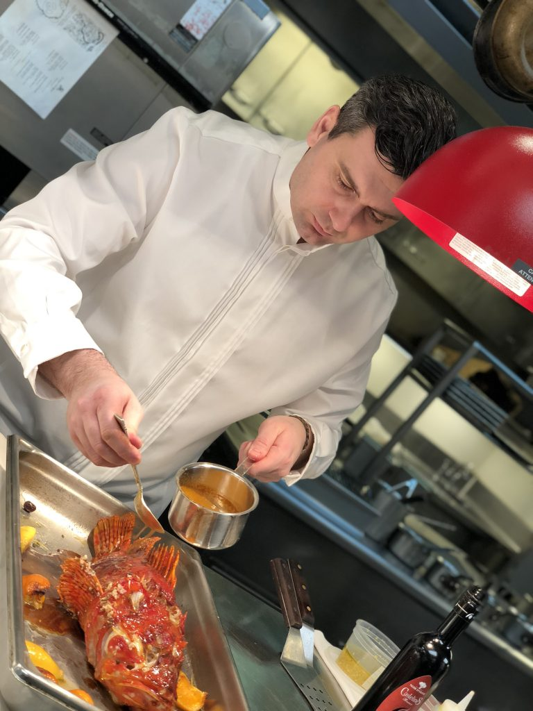 Le Chef putting the finishing touches on a Rascasse