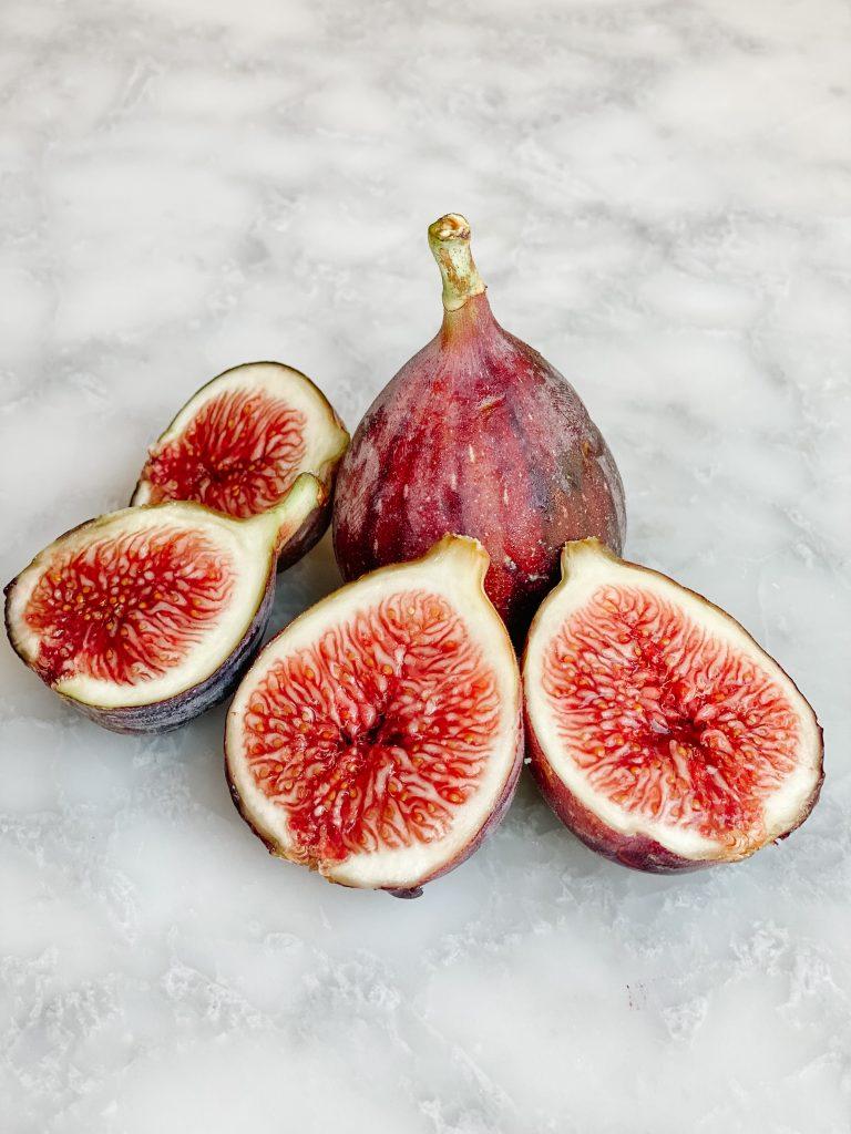 a fresh fig cut in half