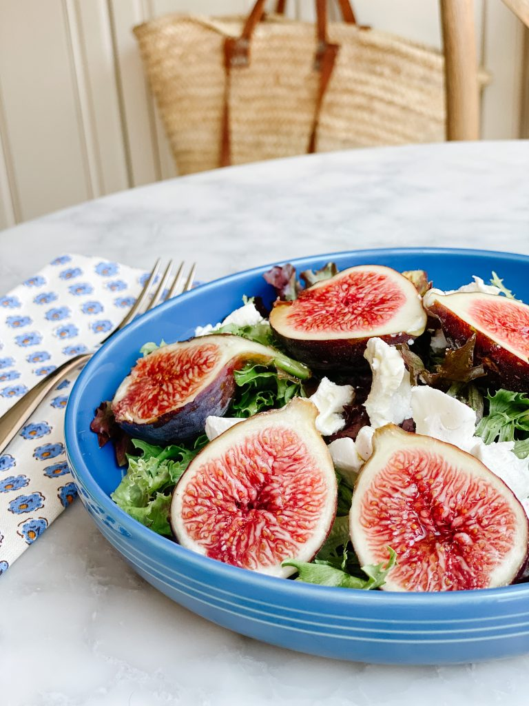 fresh figs salad with goat cheese on a blue plate
