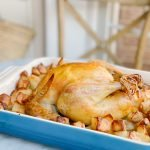 close up roast chicken and potatoes
